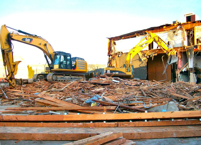 by: RITA A. LEONARD - Demolition at S.E. 14th and Gideon Street resulted in relocation of multiple tenants and the Genealogical Forum. Nearby, crews continue extensive sewer work.