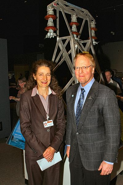 by: DAVID F. ASHTON - OMSI Executive Director Nancy Stueber welcomes PGE Senior Consultant Joe Barra to the exhibition's opening. Here, they're standing in front of an exhibit called 'Powering up Portland' to which Barra contributed ideas and technical expertise.