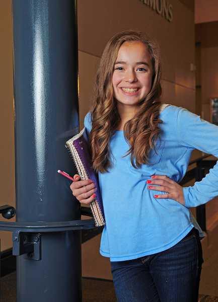 by: VERN UYETAKE  - Sarah McKay, 13, is the youngest freshman at West Linn High School. The well-rounded girl skipped two grades and estimates she spends three hours each night on homework.