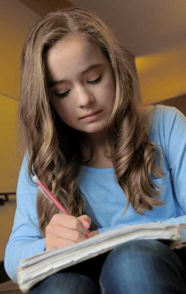 by: VERN UYETAKE  - Sarah McKay estimates she spends three hours each night on homework.
