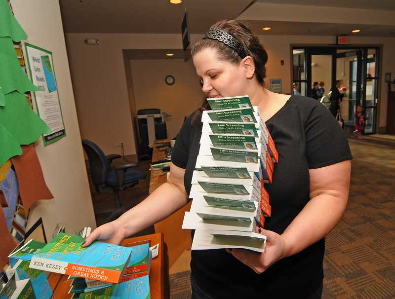 by: VERN UYETAKE - Librarian Rebecca Mayer puts out some more books for West Linn Reads.