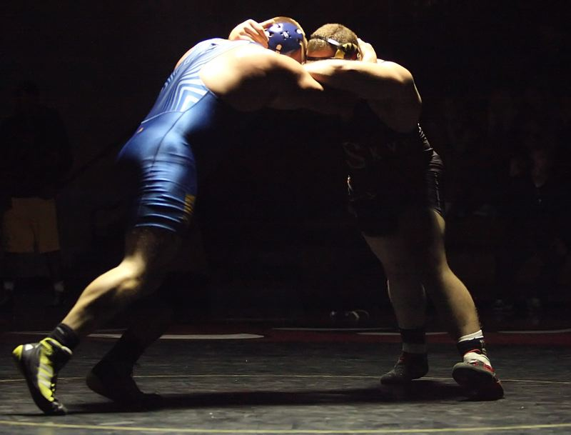 by: MILES VANCE - SILHOUETTES - Aloha senior Ryan Papenfuhs (left) and Southridge junior Travis Johnson battled into overtime at 220 pounds before Papenfuhs finally escaped with a 3-2 victory at Southridge High School on Jan. 31.