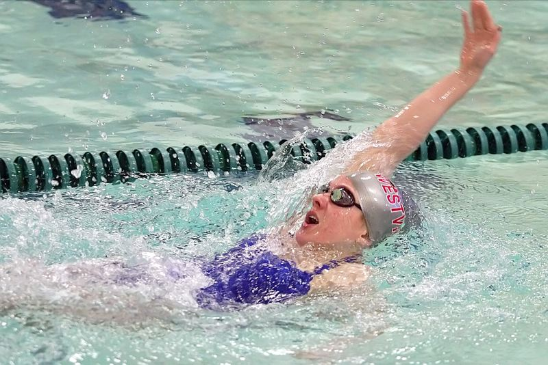 by: MILES VANCE - WILDCAT WINNER - Westview senior Michelle Cefal speeds to victory in the 100-yard backstroke during her team's Jan. 31 win over Aloha at Aloha Swim Center.