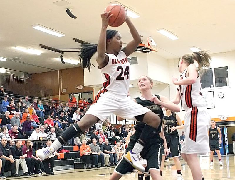 by: MILES VANCE - GOT IT - Beaverton senior Alexis Montgomery rips down a rebound in front of Southridge's Dayna Carlson during the Beavers' 59-47 Metro League win at Beaverton High School on Friday night.