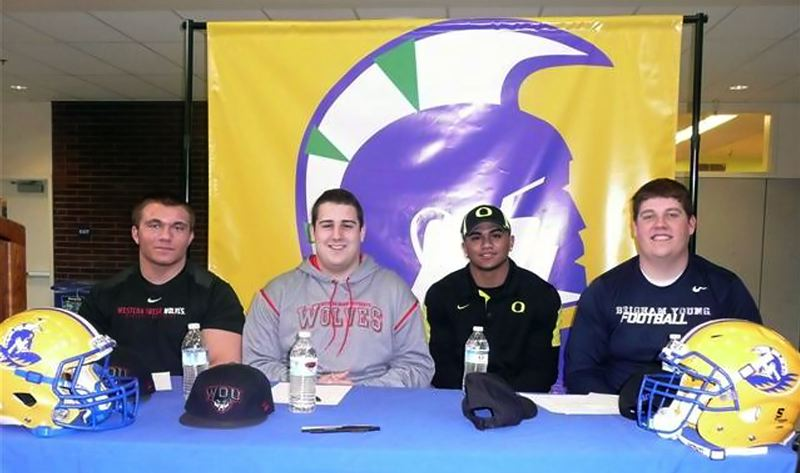 by: SUBMITTED PHOTO - ON TO COLLEGE - Aloha High School saw four members of its football team sign national letters of intent on Wednesday afternoon, including (from left) Michael Kluge, AJ McCollum, Thomas Tyner and Brayden Kearsley.