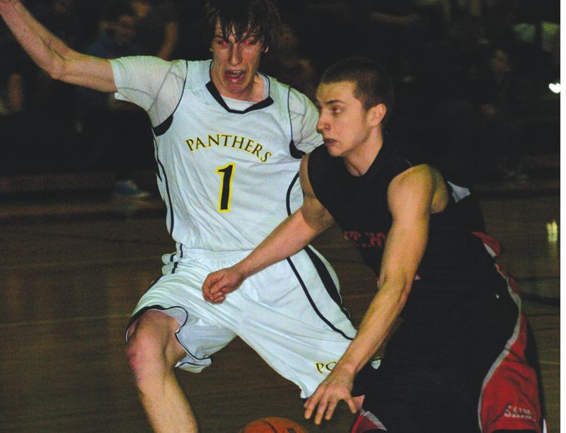 by: PAMPLIN MEDIA GROUP - Portland CC's Mike Gregory stays in front of Mt. Hood guard Blake Updike on Wednesday night. Gregory shared the team scoring lead with 16 points in the Panthers' win.