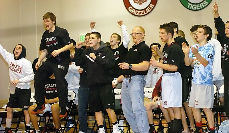 by: DAN BROOD - HOLD ON -- Tualatin High School wrestlers and coaches cheer on Frank Giannone during the final seconds of his 4-3 decision win at 160 pounds.