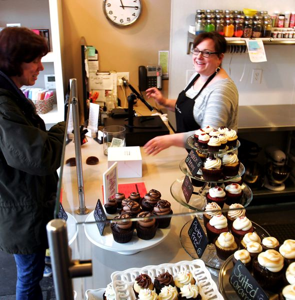 by: OUTLOOK PHOTO: JIM CLARK - Debbie Phillips, owner of Bella Cupcake, said she appreciated all of her customers after Sweet Cakes by Melissa refused to serve a same-sex couple.