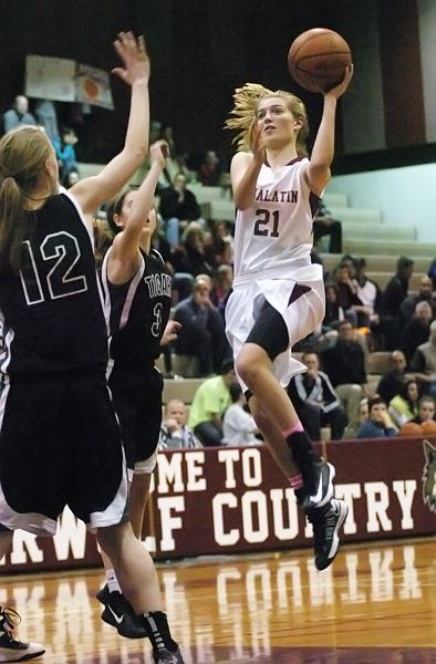 by: DAN BROOD - TAKING OFF -- Tualatin junior Lindsay Barrow drives and goes up to the basket during Friday's game with Tigard. The Tigers won in overtime.