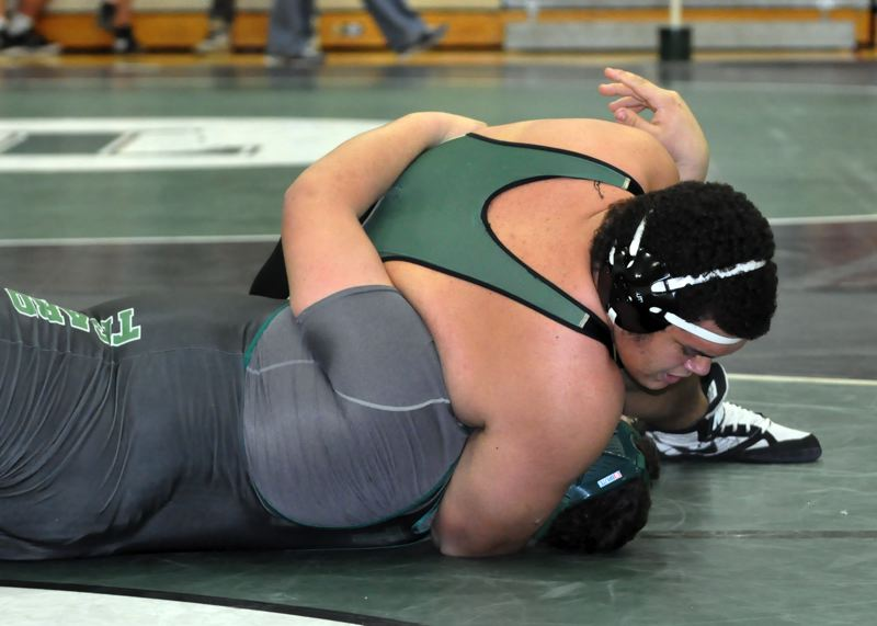 by: TRACIE KRELLWITZ - Noah Bagley moves in for a pin during a victory in the Tigard Tournament last weekend.