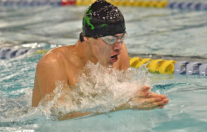 by: VERN UYETAKE - West Linn's Curtis Klein swims to a victory in the 200 individual medley during last week's meet against Lake Oswego