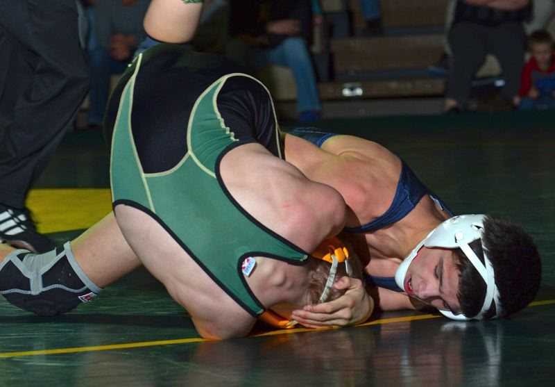 by: VERN UYETAKE - Cahleb Gonzales get his West Linn opponent on his back in his 14-4 win last week.