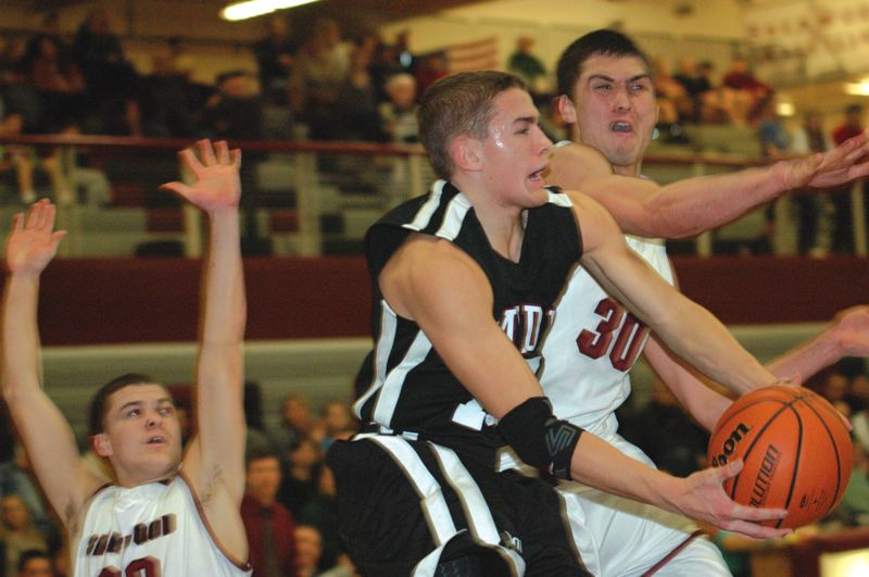 by: THE POST: PARKER LEE - Sandys Jacob Groom goes up for a reverse layup during Fridays home loss to the Bowmen.