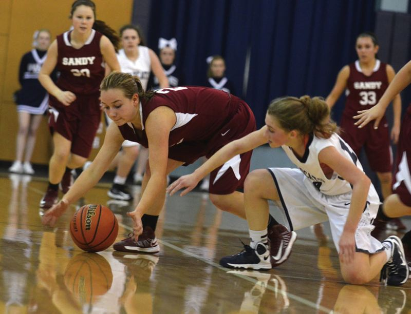 by: PAMPLIN MEDIA GROUP: JEFF GOODMAN - Sandys Madi Schmautz chases down a loose ball near half-court during last weeks loss at Wilsonville.
