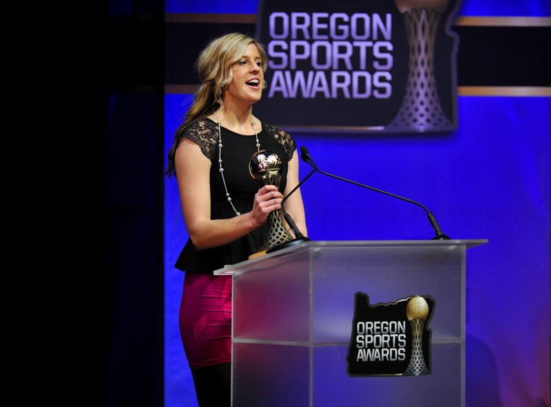 by: JOHN LARIVIERE - Gresham High track and field star Haley Crouser accepts one of her two trophies at the Oregon Sports Awards. Crouser won the Johnny Carpenter Prep Athlete of the Year Award for Class 6A-5A girls and was voted as the top female track and field athlete in the state for 2012.