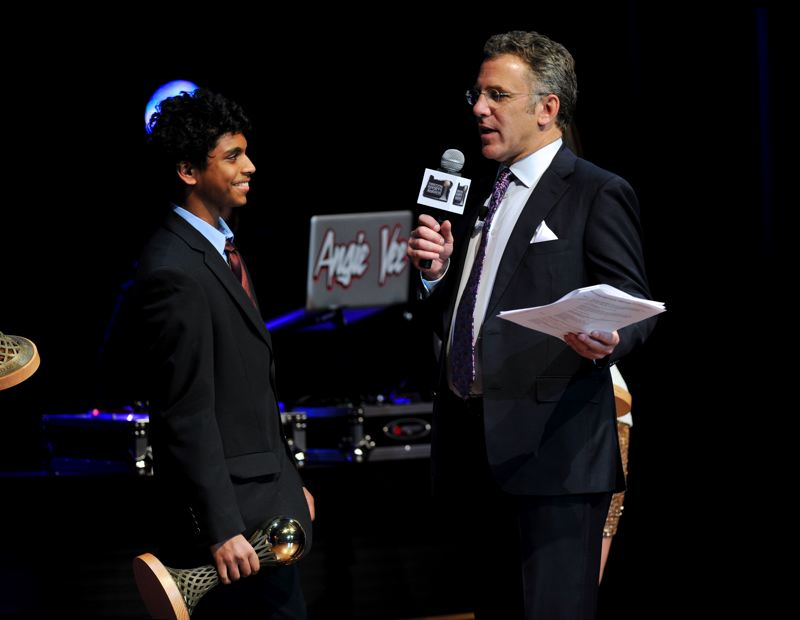 by: JOHN LARIVIERE - Goutham Sundaram (left) of Lincoln High chats with Oregon Sports Awards host Neil Everett of ESPN as Sundaram receives the Prep Boys Tennis Athlete of the Year Award for 2012 on Sunday at Nike.