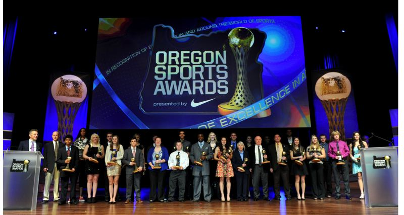 by: JOHN LARIVIERE - Oregon Sports Awards winners gather on stage at the end of Sunday's show at Nike's Tiger Woods Center.