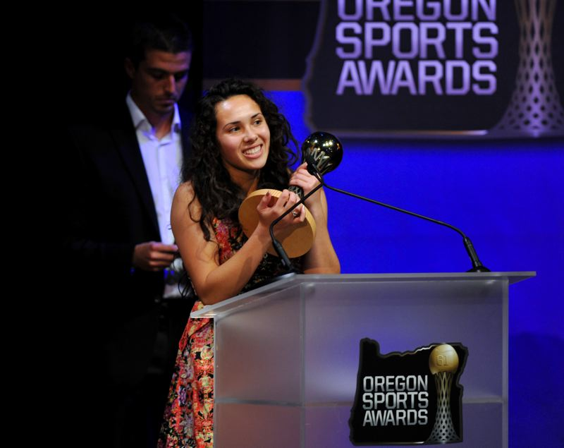 by: JOHN LARIVIERE - Ariel Viera accepts the Prep Girls Soccer Player of the Year Award at the Oregon Sports Awards.