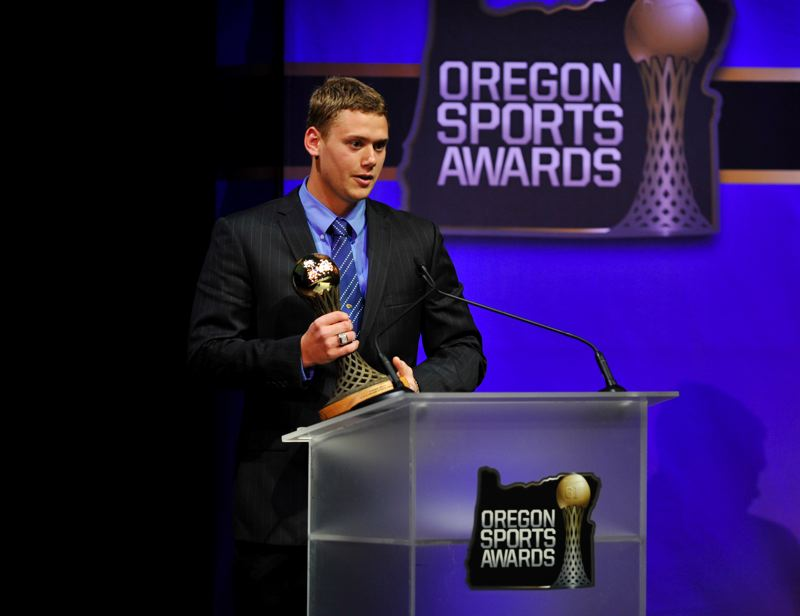 by: JOHN LARIVIERE - Carson Kelly, who is going from Westview High to the St. Louis Cardinals organization, gives thanks as he receives the Prep Baseball Player of the Year Award at the Oregon Sports Awards.