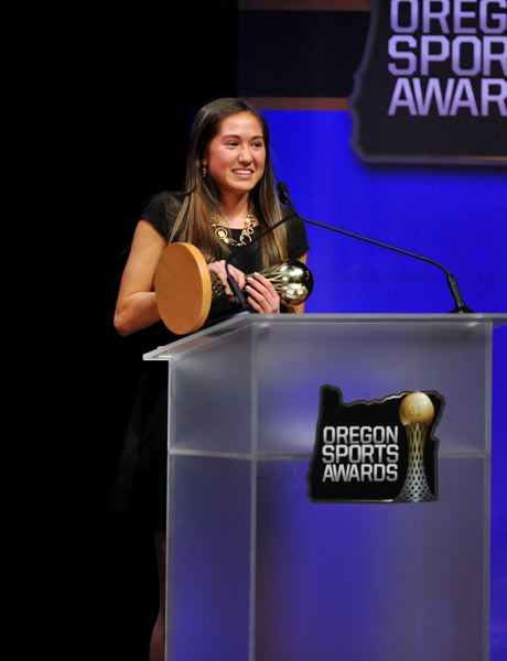 by: JOHN LARIVIERE - South Eugene High's state cross country champion, Sara Tsai, tells a story as she accepts her award during Sunday's 61st Oregon Sports Awards at Nike's Tiger Woods Center.