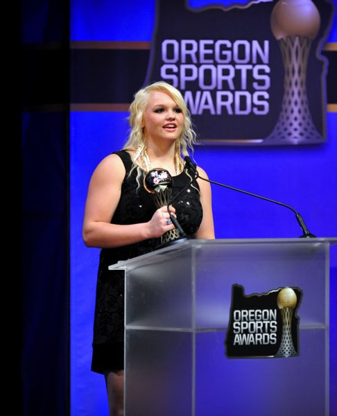 by: JOHN LARIVIERE - Heppner High's Baily Bennett is awarded the Johnny Carpenter Prep Athlete of the Year trophy for Class 4A-3A-2A-1A girls at the Oregon Sports Awards.