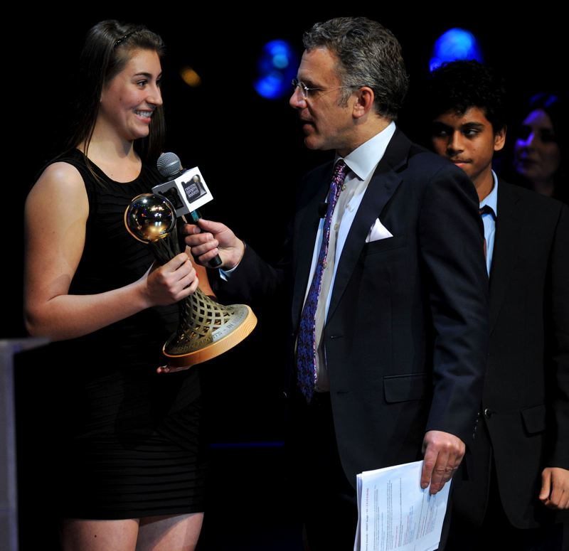 by: JOHN LARIVIERE - Beaverton High's Gigi Stoll, the Prep Girls Golfer of the Year, chats with ESPN's Neil Everett, host of Sunday's Oregon Sports Awards.