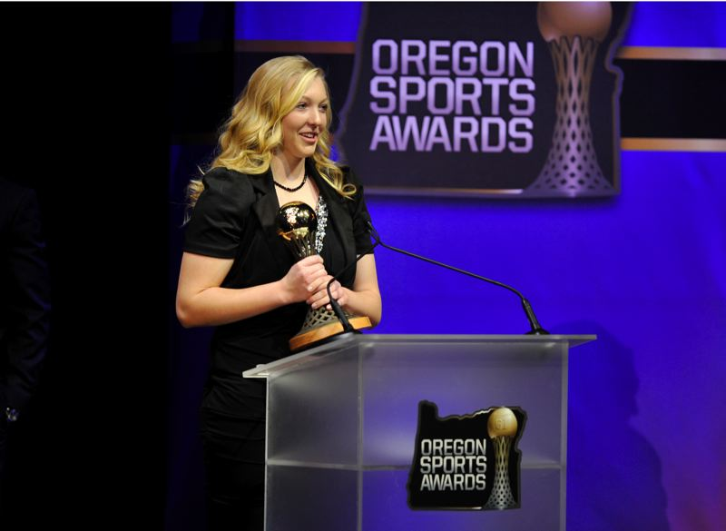 by: JOHN LARIVIERE - Maryssa Becker, North Medford High softball pitcher, offers thanks after winning the Prep Softball Player of the Year Award for 2012 at Sunday's Oregon Sports Awards, hosted by Nike.