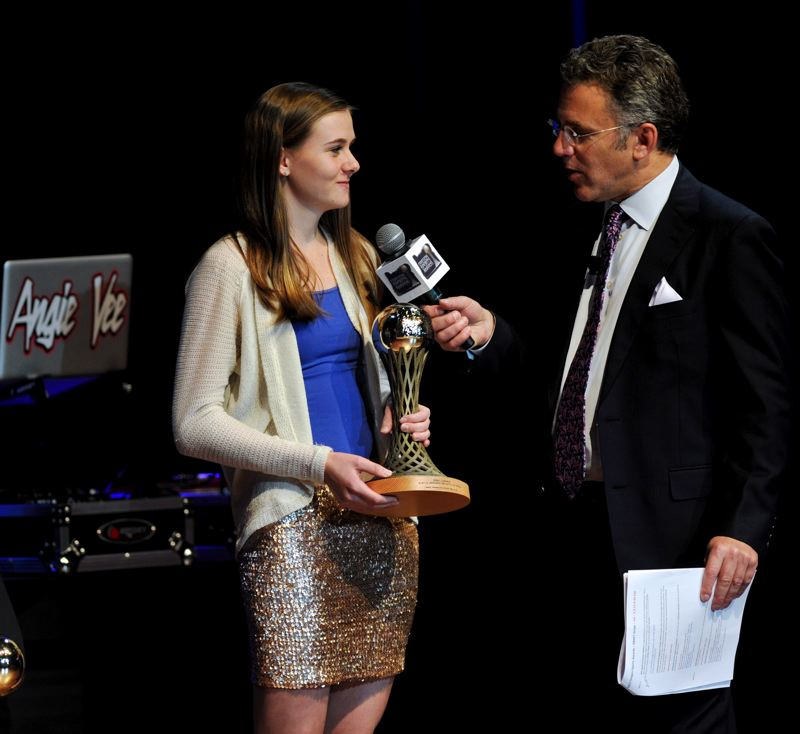 by: JOHN LARIVIERE - The Prep Girls Tennis Player of the Year, Erin Larner of Jesuit High, tells Oregon Sports Awards host Neil Everett that if she could pick anyone to hit balls with for an hour, her choice would be Roger Federer.