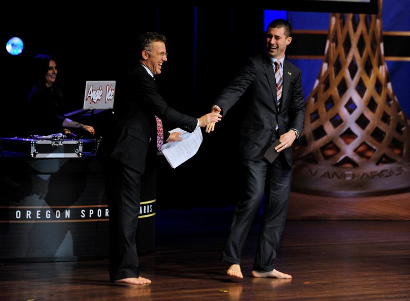 by: JOHN LARIVIERE - ESPN's Neil Everett (left) and Fox Sports' Joey Harrington have fun with their similar footwear (or lack therof) during the Oregon Sports Awards stage show Sunday at Nike's Tiger Woods Center.