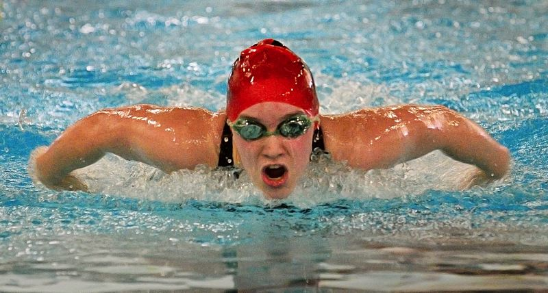 by: VERN UYETAKE - Clackamas freshman Lainey Visscher was a part of four school records at last weekends Three Rivers League District Swim Meet, held at the Lake Oswego Municipal Pool. Visscher heads to next weekends state meet ranked in the top three in the state in two individual events.