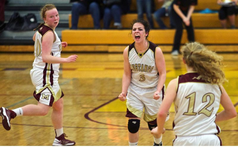 by: JAIME VALDEZ - Milwaukie senior Lorissa Martine (3) is overcome with emotion after classmate April Meads (left) hits a late-game 3-pointer in last Fridays Northwest Oregon Conference game with Liberty. The basket put the Mustangs up 42-40 and they went on to win 43-40, earning their sixteenth straight victory.