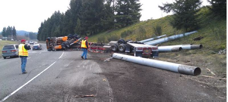 by: COURTESY OF ODOT - Oregon Department of Transportation crews worked to clear a truck rollover accident Tuesday morning that blocks the I-205 northbound ramp just south of I-5. No one was injured in the crash that happened at about 8:25 a.m.