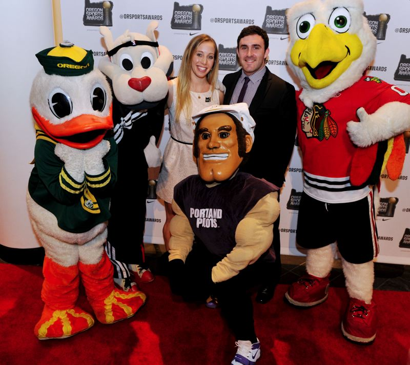 by: JOHN LARIVIERE - Fencing great Mariel Zagunis and friends, including mascots from the Oregon Ducks, Trail Blazers, Portland Pilots and Portland Winterhawks.