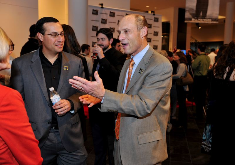 by: JOHN LARIVIERE - Oregon State football coach Mike Riley, who won the Slats Gill Sportsperson of the Year Award in 2008 and was one of six semifinalists for 2012, shares a story in the lobby before Sunday's Oregon Sports Awards at Nike.