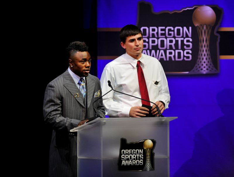 by: JOHN LARIVIERE - Two football stars from the Oregon Ducks, Kenjon Barner (left) and David Paulson, help announce the finalists for an award.