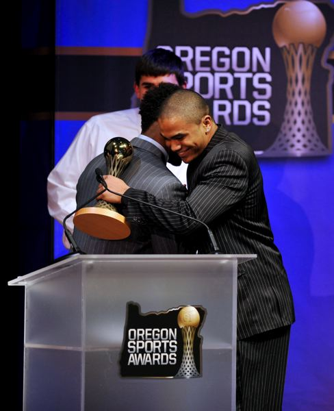 by: JOHN LARIVIERE - Kenjon Barner from the Oregon Ducks gives new UO signee Thomas Tyner of Aloha High a hug after Tyner won the Prep Football Player of the Year Award for 2012.