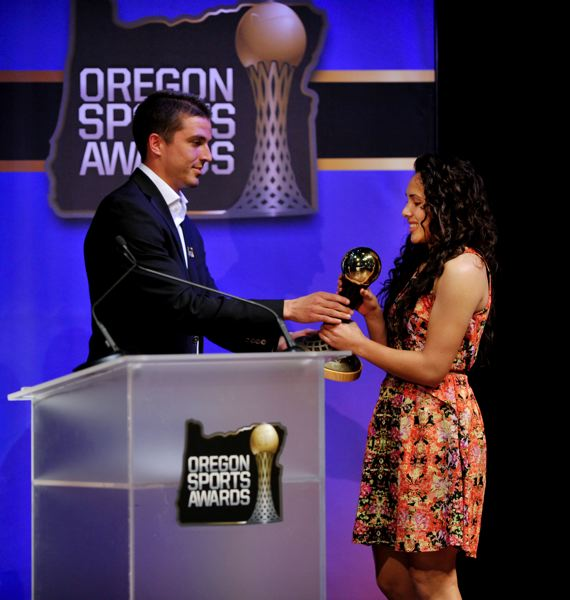 by: JOHN LARIVIERE - Ryan Kowaluk (left) of the Portland Timbers hands out the Prep Girls Soccer Player of the Year Award to Ariel Viera from Scappoose High.