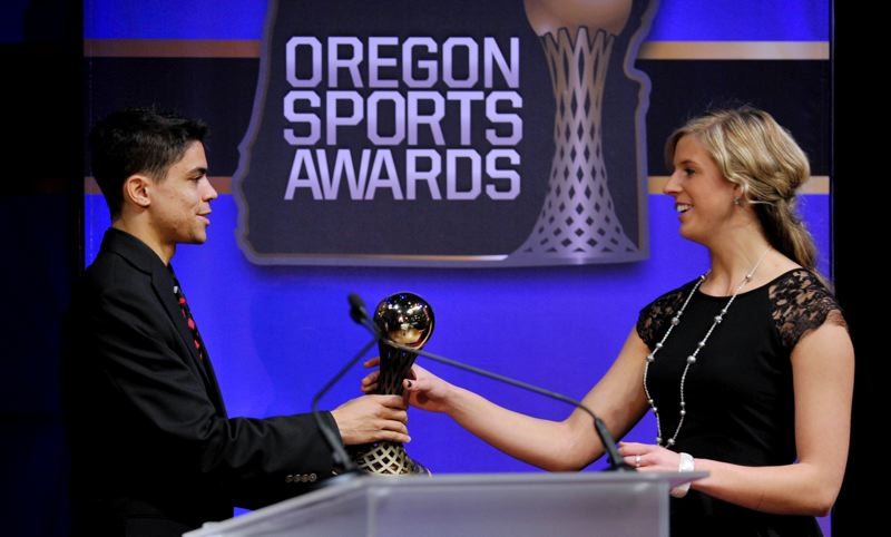 by: JOHN LARIVIERE - Track standout Matthew Centrowitz (left) gives out an award to Gresham High track and field star Haley Crouser.