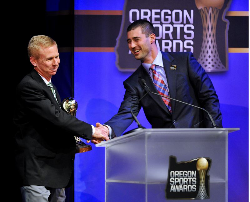by: JOHN LARIVIERE - Oregon Ducks volleyball coach Jim Moore, whose team reached the NCAA finals in 2012, accepts the Bill Hayward Amateur Athlete of the Year Award for UO multisport star Elizabeth Brenner, with congratulations from former Duck quarterback Joey Harrington. Brenner offered her own thanks via video because she was in Colorado on Sunday playing basketball for Oregon.