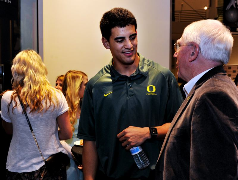 by: JOHN LARIVIERE - Oregon Ducks quarterback Marcus Mariota chats with UO public address announcer Don Essig at the Oregon Sports Awards.