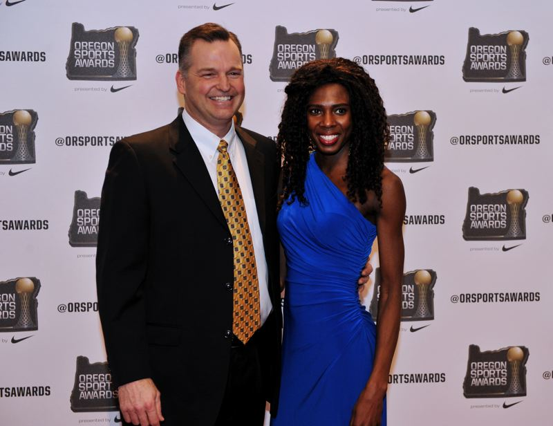by: JOHN LARIVIERE - Concordia University sprinter Junia Limage (right) was one of three finalists for the Ad Rutschman Small College Female Athlete of the Year Award. She shares a photo opportunity at the Oregon Sports Awards with former Concordia coach Randy Dalzell, now at George Fox University.