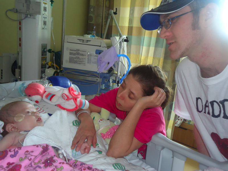 by: PHOTO COURTESY: VICTORIA DANIELS - Victoria Daniels and Kevin Love's daughter Lucy recovers from an open-heart surgery May 22, 2012, for a heart defect.