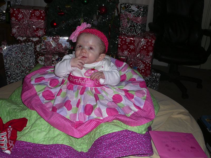 by: PHOTO COURTESY: VICTORIA DANIELS - Victoria Daniels' daughter Lucy celebrates turning 1 after recoving from open-heart surgery.