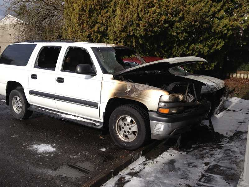 by: SUBMITTED PHOTO: TVF&R - Tualatin Valley Fire & Rescue fire investigators are looking into what caused this vehicle to catch fire Tuesday morning in a Beaverton apartment complex parking lot.
