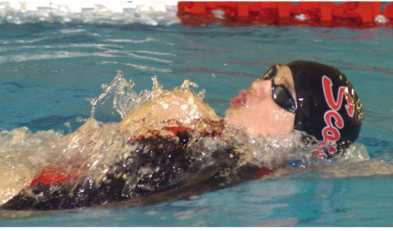 by: THE OUTLOOK: DAVID BALL - Emma Nissen of David Douglas glides through the water during the backstroke Saturday. She won the 200 medley race earlier in the meet.