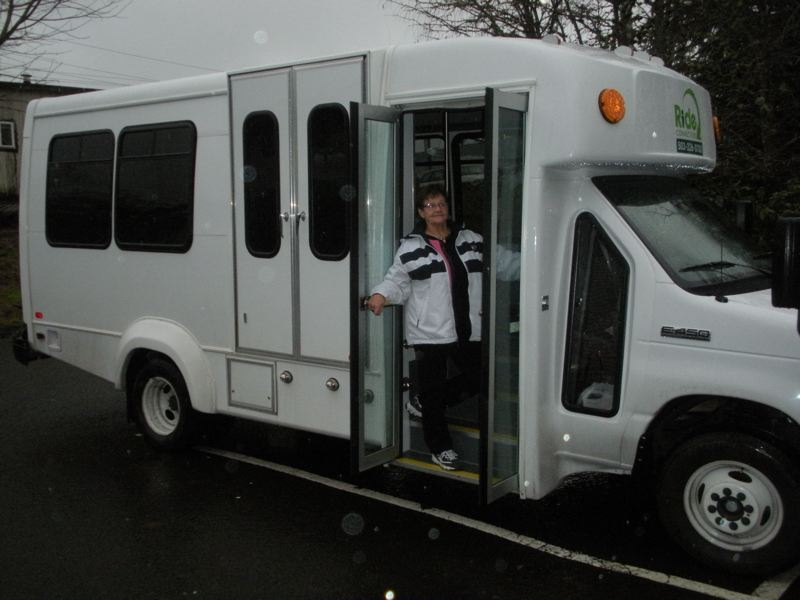 by: POST PHOTO: JIM HART - Senior center driver JoAnn Bernhardt stands in the doorway of the 14-passenger van she drives to take local seniors to places of interest. POST PHOTO: JIM HART
