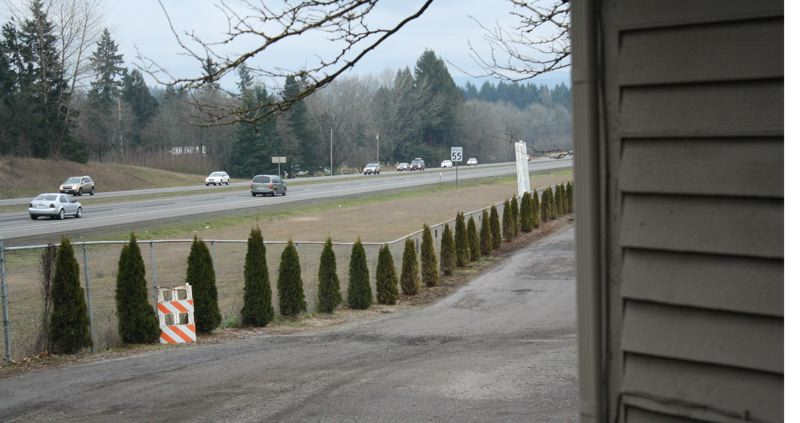 by: POST PHOTO: JIM HART - Part of this home and the narrow roadway, adjacent to Highway 26, are both inside the 50-foot buffer that would require trees under provisions of the agreement between the city of Sandy, Metro and Clackamas County.  POST PHOTO: JIM HART
