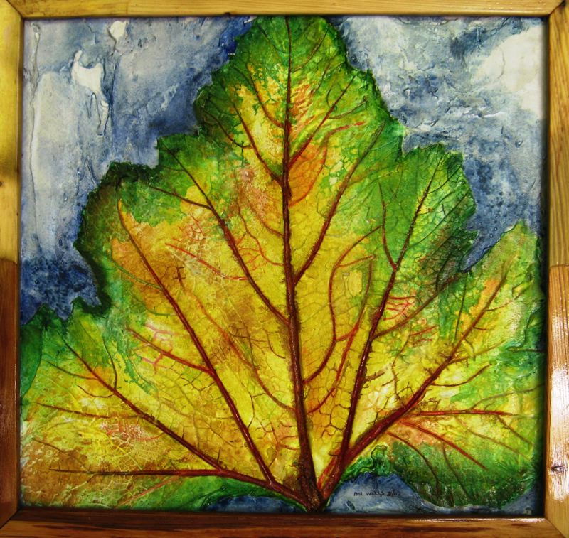 "by: CONTRIBUTED PHOTO: PHIL WELLS - This is the work of artist Phil Wells of Boring. It is one of his eye-catching art pieces, using mortar, acrylic paint, glaze, an impression of a zucchini leaf; and it€sˇÃ""ôs all framed with recycled wood. CONTRIBUTED PHOTO: PHIL WELLS"