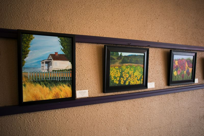 by: NEWS-TIMES PHOTO: CHASE ALLGOOD - Landscapes and flowers are among the subjects captured by artist Maureen Zoebelein in her oil paintings, 15 of which are on display through Feb. 28 at Caffe Montecassino in Forest Grove.