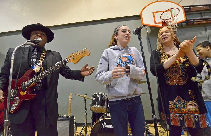 by: VERN UYETAKE - Lexie Pritchard, seventh grade, center, sings along with Norman Sylvester and LaRhonda Steele during last weeks RAD Rock day at Rosemont Ridge.